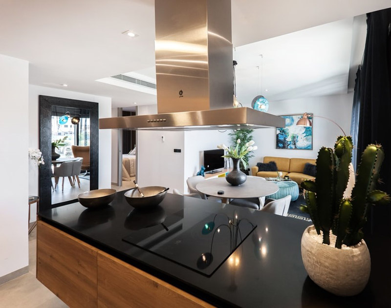 Open-concept kitchen, dining and living rooms