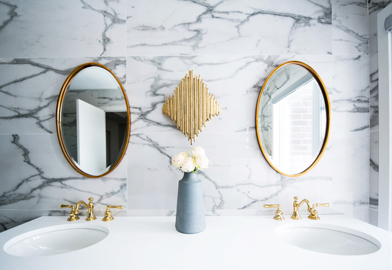 Gold accents and plumbing fixtures
